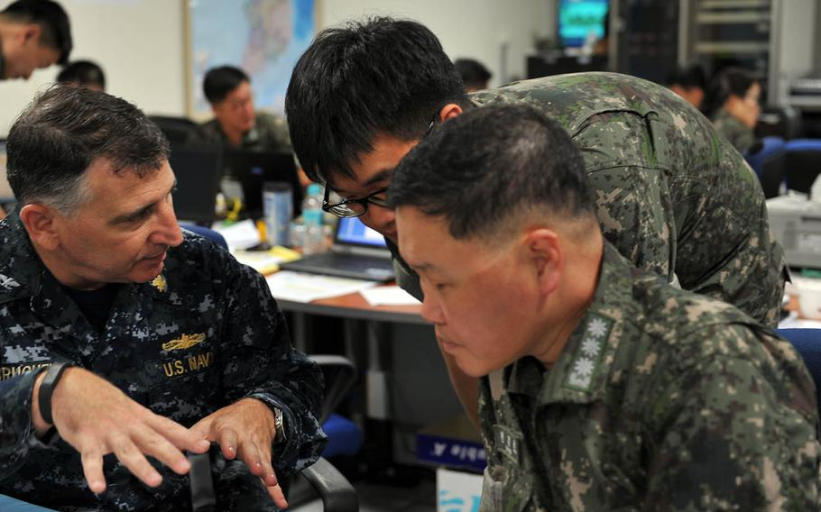 American and South Korean sailors work together during the Ulchi Freedom Guardian exercise in August 2014.
