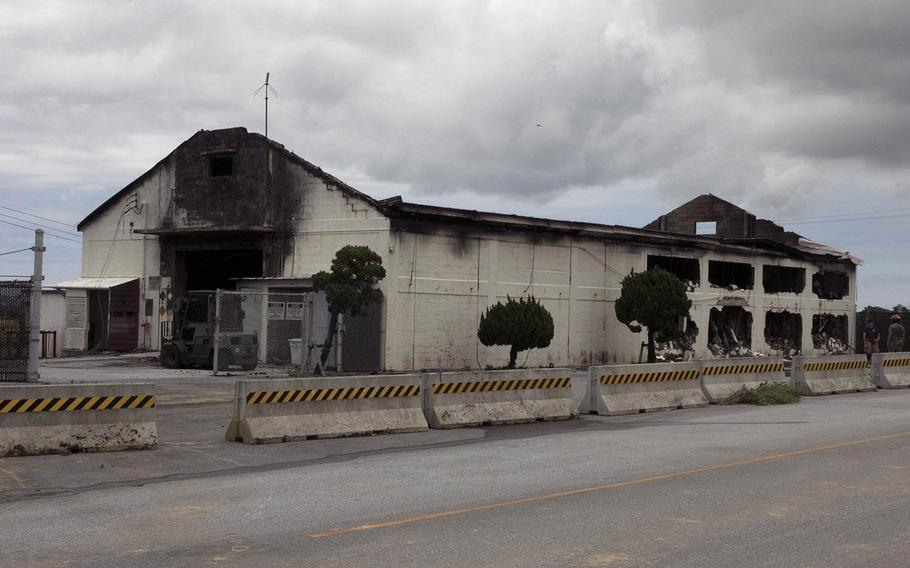 An Air Force Ground Accident Investigation Board report blamed improperly stored chemicals for a fire that destroyed a warehouse at Kadena Air Base, Okinawa, on June 22, 2020.