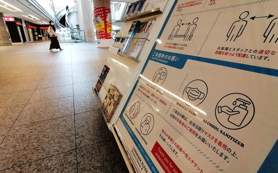 A shopping center in Yokohama, Japan, encourages customers to take measures to prevent a coronavirus infection on Jan. 6, 2021.