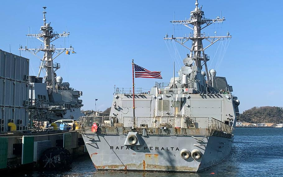 The guided-missile destroyer USS Rafael Peralta docks at Yokosuka Naval Base, Japan, Thursday, Feb. 4, 2021.