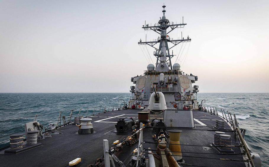 The guided-missile destroyer USS John S. McCain steams near the Paracel Islands in the South China Sea, Friday, Feb. 5, 2021.