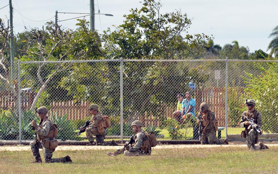 Locals watch U.S. Marines train in the Australian state of Queensland, July 22, 2019.
