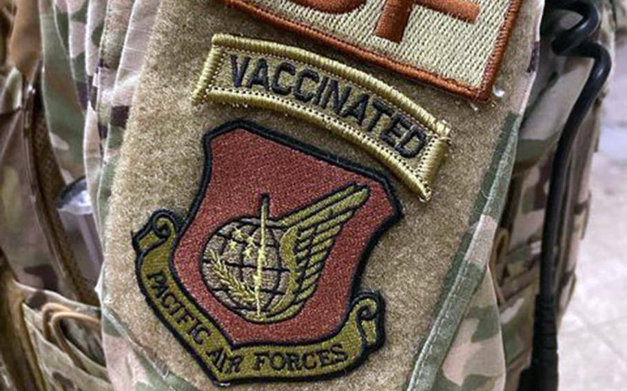 """A security forces airman wears a """"vaccinated"""" morale patch in this screenshot from the popular Air Force amn/nco/snco Facebook page."""