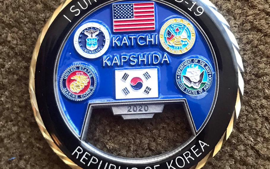 """This challenge coin features the U.S. and South Korean flags, along with the phrases """"Katshi Kapshida""""(Go Together) and """"I Survived COVID-19."""""""