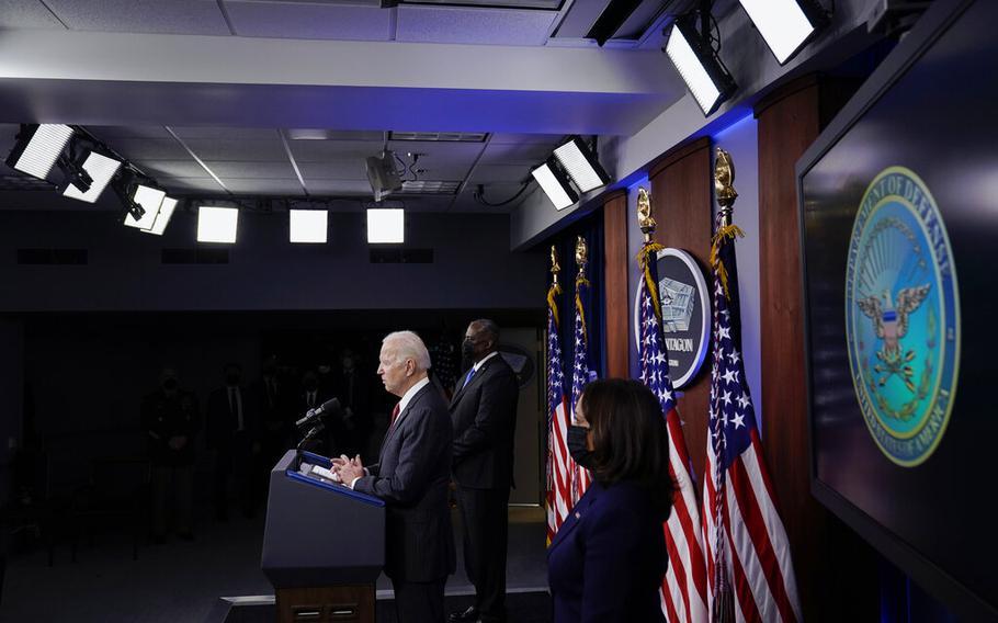 President Joe Biden speaks as Secretary of Defense Lloyd Austin and Vice President Kamala Harris accompany him at the Pentagon, Wednesday, Feb. 10, 2021, in Washington.