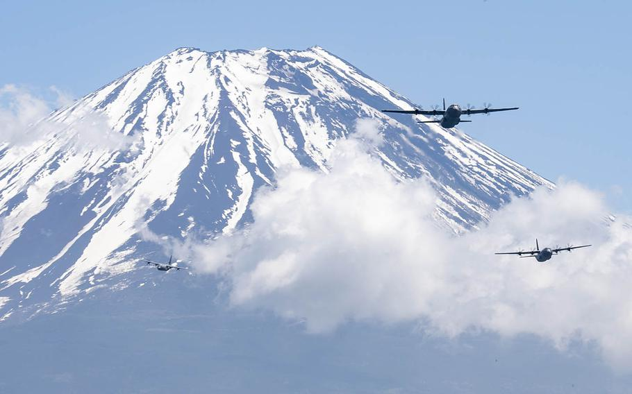 Three C-130J Super Hercules assigned to the 36th Airlift Squadron at Yokota Air Base fly near Mount Fuji, Japan, May 11, 2020.