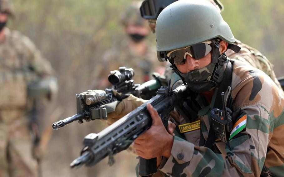 Soldiers with India's 11th Jammu And Kashmir Rifles Battalion and the U.S. Army's 2-3 Infantry Patriots Battalion, 1-2 Stryker Brigade Combat Team, practice small-unit infantry tactics during the Yudh Abhyas exercise in India being held through Feb. 21, 2021.