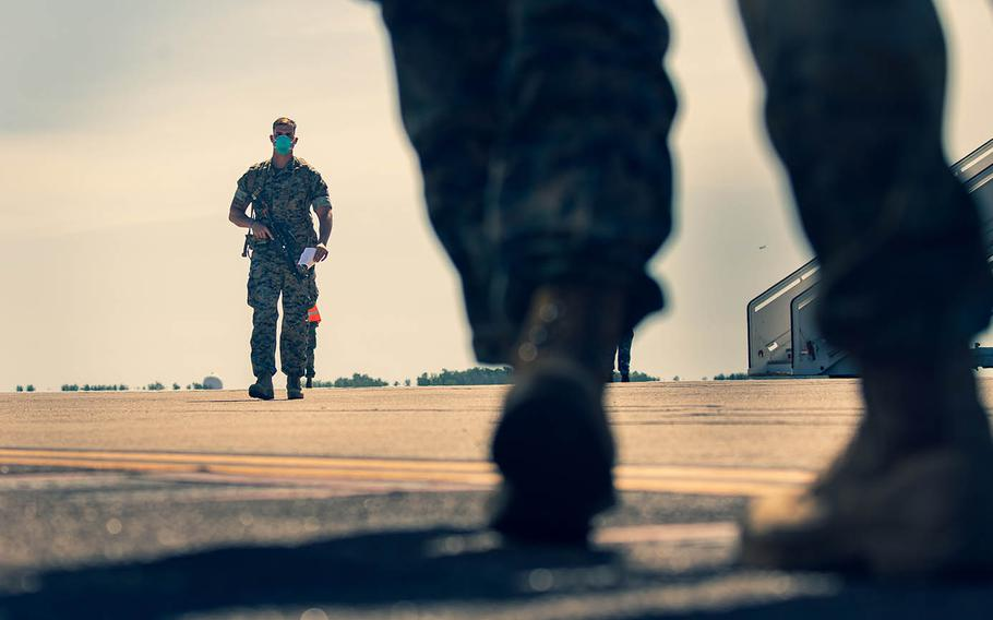 Members of Marine Rotational Force — Darwin arrive at Royal Australian Air Force Base Darwin in the Northern Territory, July 8, 2020.
