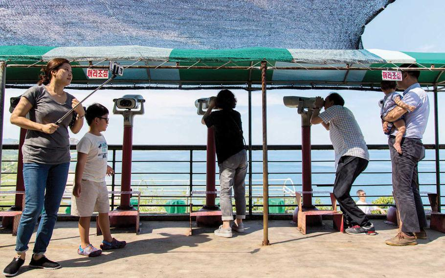 Tourists spy on North Korea near Goseong, South Korea, in the northeastern Gangwon province on Aug. 26, 2017. A man, intercepted at 7:20 a.m. by South Korean troops inside the civilian control line just south of the Demilitarized Zone, apparently swam some part of the way from North Korea in a dive suit before passing through a drain south the border  in the northeastern Gangwon province.