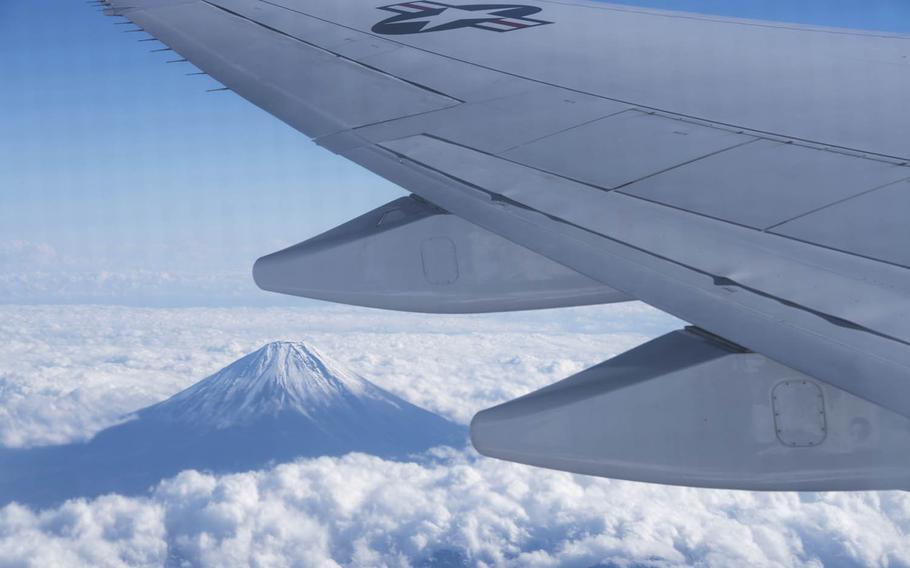 An Air Force E-4B flies west of Mount Fuji, Japan, Dec. 7, 2016.