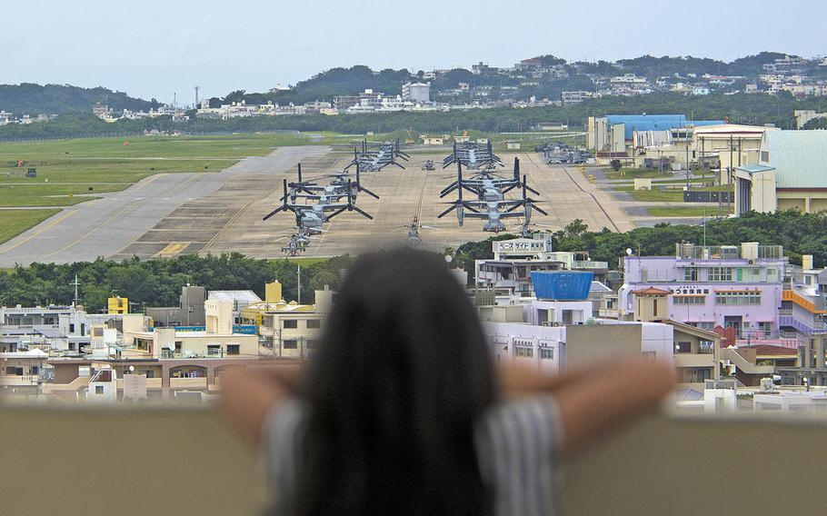 A child looks out at Marine Corps Air Station Futenma, Okinawa, April 19, 2019.