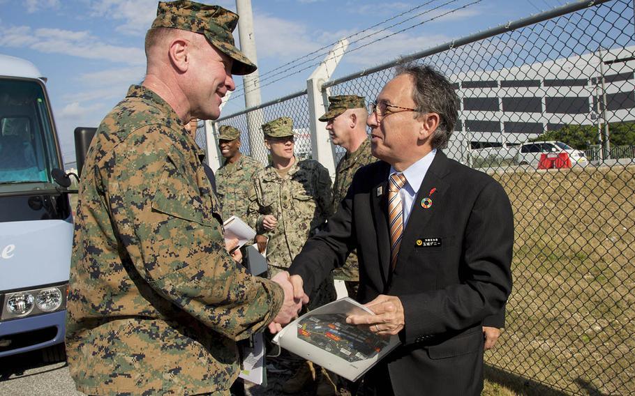 Okinawa Gov. Denny Tamaki speaks with Marine Corps Brig. Gen. Christopher McPhillips during a tour of Camp Kinser, Okinawa, Jan. 31, 2019.