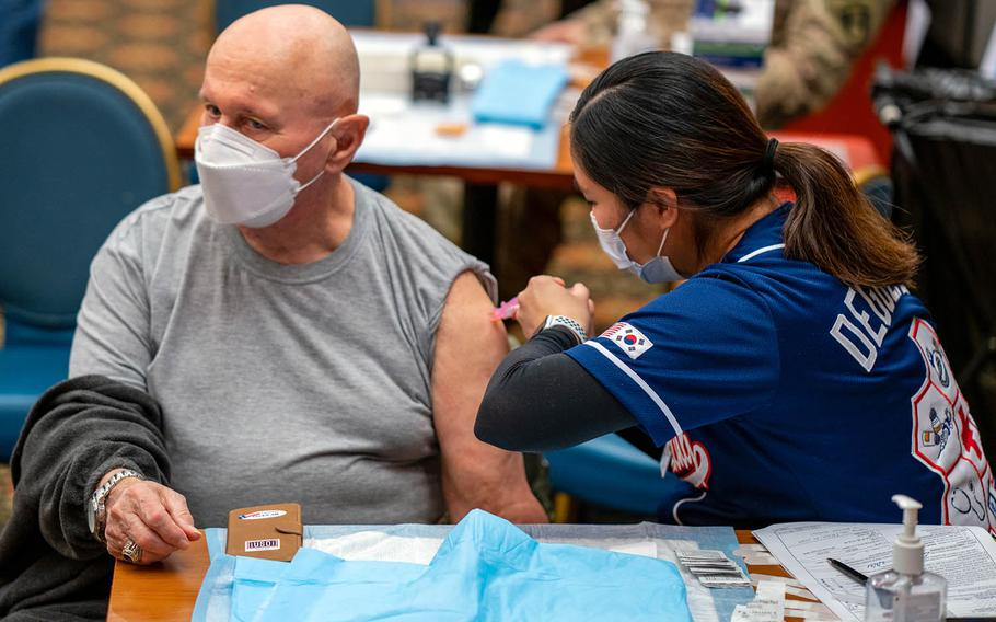 Ernest Lee, Veterans of Foreign Wars community director and a U.S. military retiree living in South Korea, receives his first dose of the Moderna COVID-19 vaccine at Osan Air Base, Feb. 5, 2021.