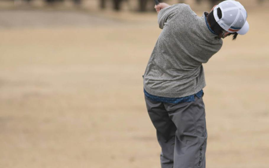 Jayden Ruby tees off during a round of golf on the Par 3 course at Yokota Air Base in western Tokyo, Thursday, Feb. 18, 2021.