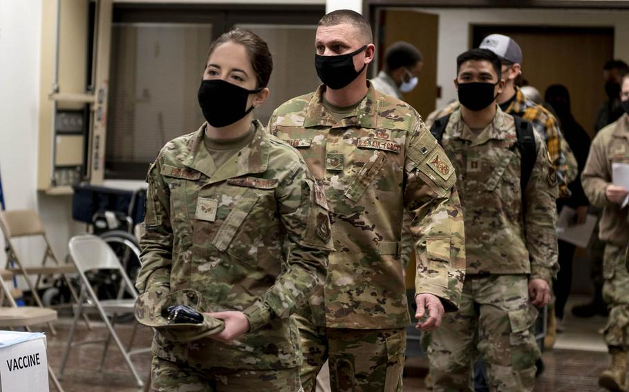 Service members wait to receive their first round of the Moderna COVID-19 vaccine at Osan Air Base, South Korea, Dec. 29, 2020.
