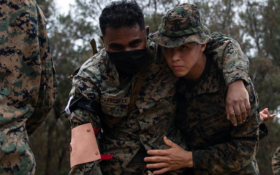 Then-Lance Cpl. Rene PonceAvalos, right, helps a simulated casualty during a humanitarian assistance and disaster-relief exercise at Okinawa's Kin Blue training area, Sept. 9, 2020. PonceAvalos died Sunday, Feb. 28, 2021, after surfing near Ikei Island.
