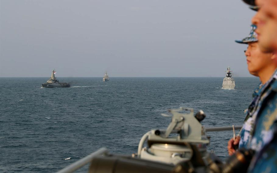 Chinese warships steam through the South China Sea during an exercise with the Singaporean navy, Feb. 24, 2021.