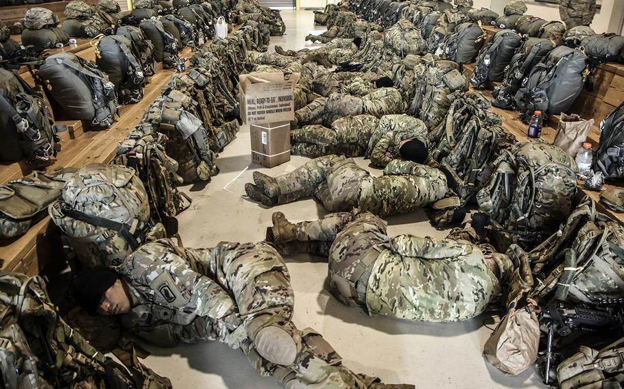 Paratroopers from the 173rd Airborne Brigade catch up on their sleep after working through the night to prepare for a combat equipment jump in Italy, April, 17, 2018.