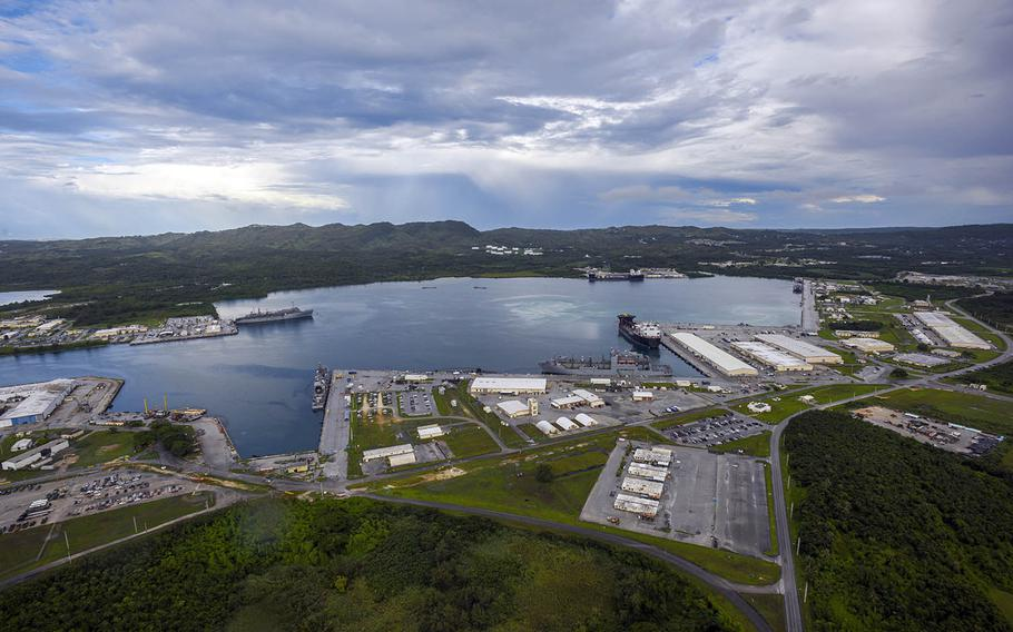 This aerial view of Naval Base Guam shows Apra Harbor with several Navy vessels in port, Aug. 24, 2020.