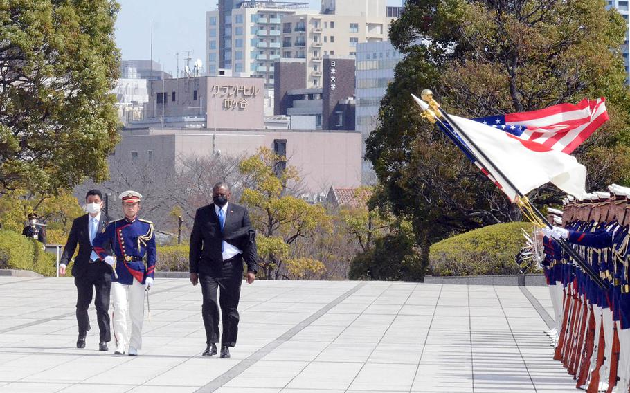 Secretary of Defense Lloyd Austin and Japanese Defense Minister Nobuo Kishi inspect troops at the Ministry of Defense in Tokyo, Tuesday, March 16, 2021.