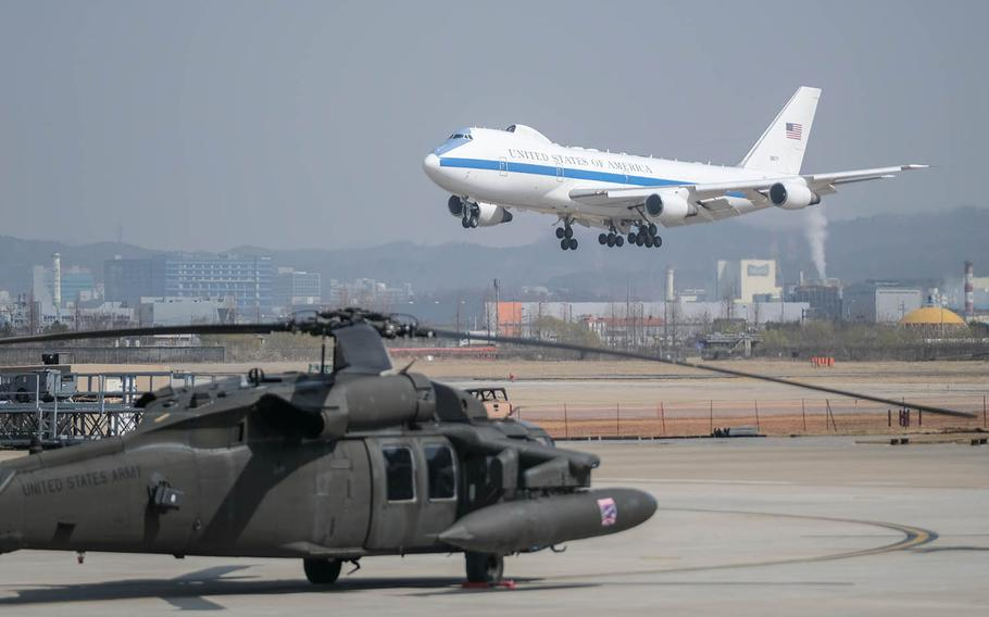 A plane carrying Defense Secretary Lloyd Austin prepares to touch down at Osan Air Base, South Korea, Wednesday, March 17, 2021.