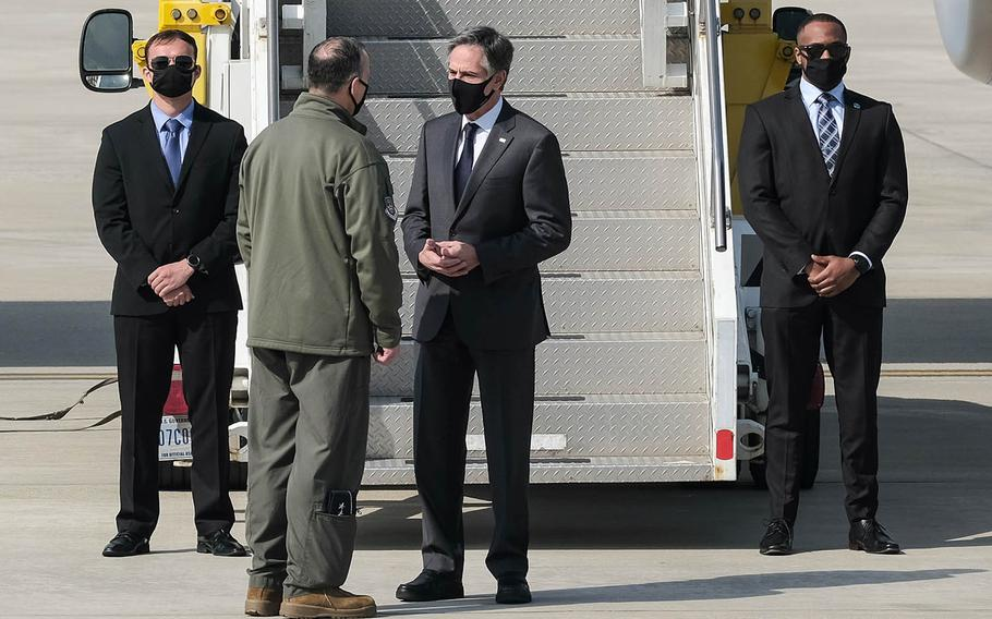 Secretary of State Antony Blinken chats with the 7th Air Force commander, Lt. Gen. Scott Pleus, after landing at Osan Air Base, South Korea, Wednesday, March 17, 2021.