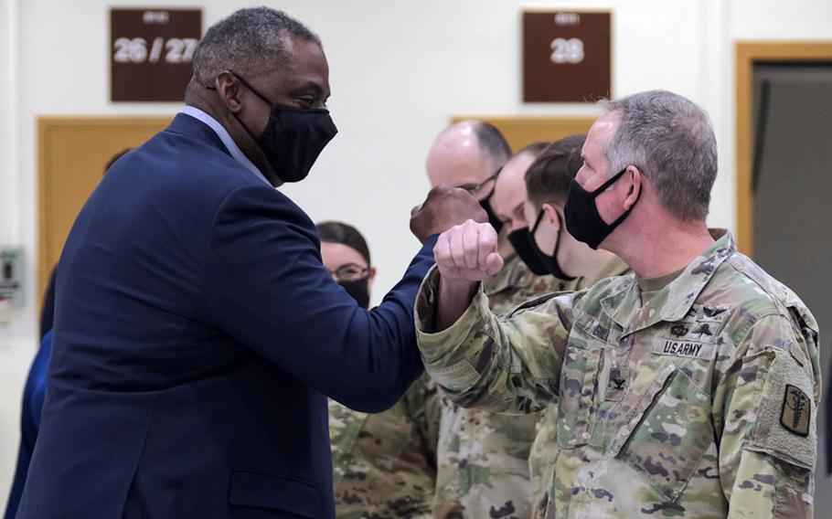 Defense Secretary Lloyd Austin greets a soldier with an arm bump at Osan Air Base, South Korea, Friday, March 19, 2021.
