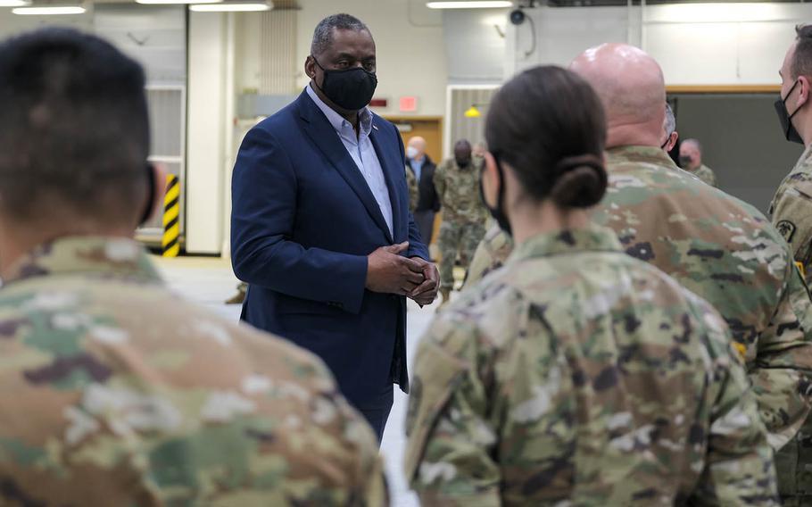 Defense Secretary Lloyd Austin speaks with service members at Osan Air Base, South Korea, Friday, March 19, 2021.