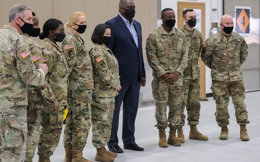 Defense Secretary Lloyd Austin poses for a photo with service members minutes before departing Osan Air Base, South Korea, Friday, March 19, 2021.