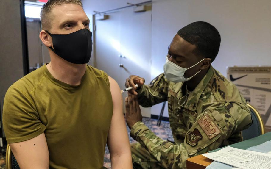 An airman assigned to the 51st Fighter Wing receives the Jannsen COVID-19 vaccine at Osan Air Base, South Korea, March 11, 2021.