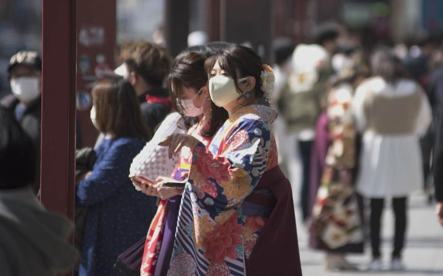 Protective masks are still part of the pandemic wardrobe in Tokyo, even for these women in traditional attire near Sensoji temple on March 17, 2021.