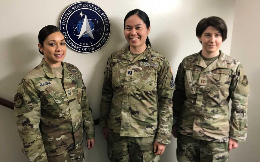Space Force members, from left, Senior Master Sgt.  Marivic Olivera and Capt. Jessica Wong, shown here with Air Force Capt. Laura Marshall on March 24, 2021, signed up at Yokota Air Base, Japan.