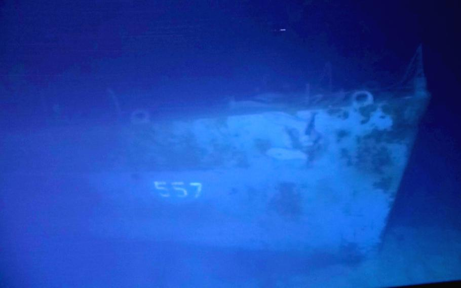 The hull number 557 on the USS Johnston is visible four miles below the surface of the Philippine Sea in a photo taken by divers in March 2021.