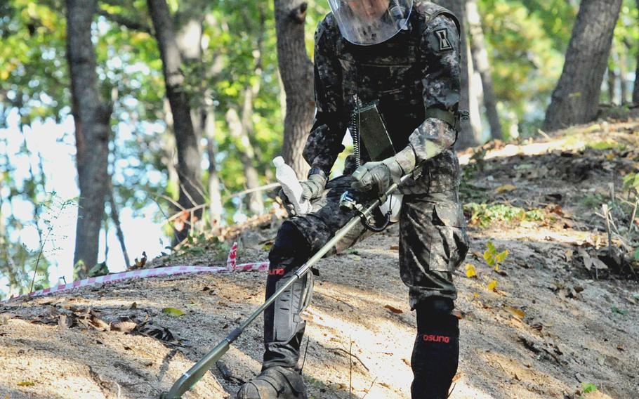 A South Korean soldier works a metal detector at Arrowhead Hill in the Demilitarized Zone in a hunt for leftover mines of the Korean War on Oct. 8, 2018.