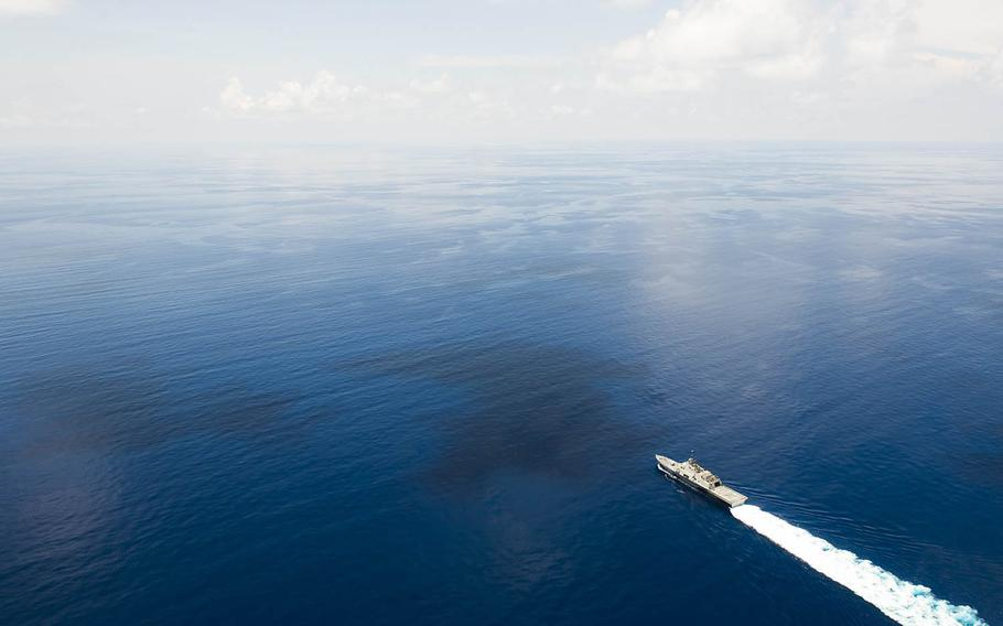 The littoral combat ship USS Fort Worth, trailed by a Chinese guided-missile frigate, sails near the Spratly Islands in the South China Sea, May 11, 2015.