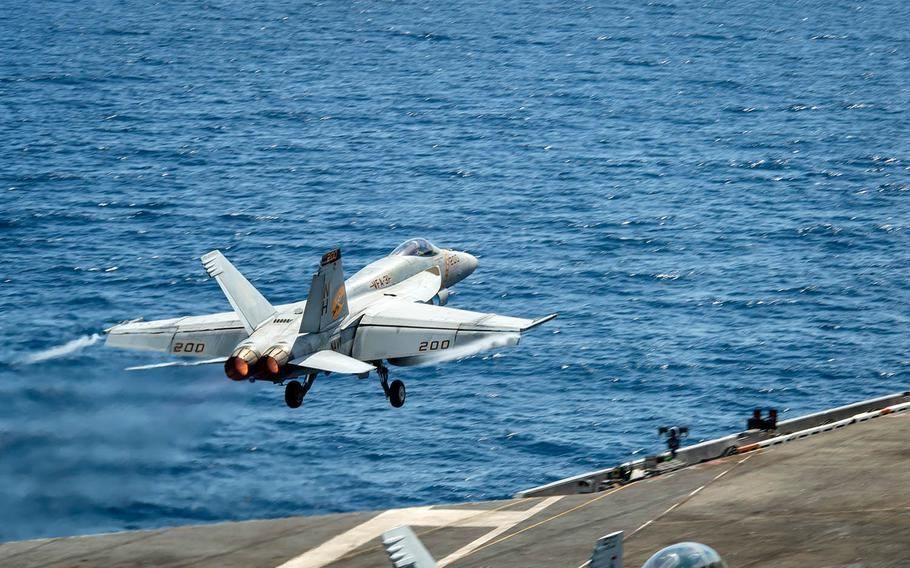 An F/A-18E Super Hornet  launches from the aircraft carrier USS Theodore Roosevelt in the South China Sea, Tuesday, April 6, 2021.