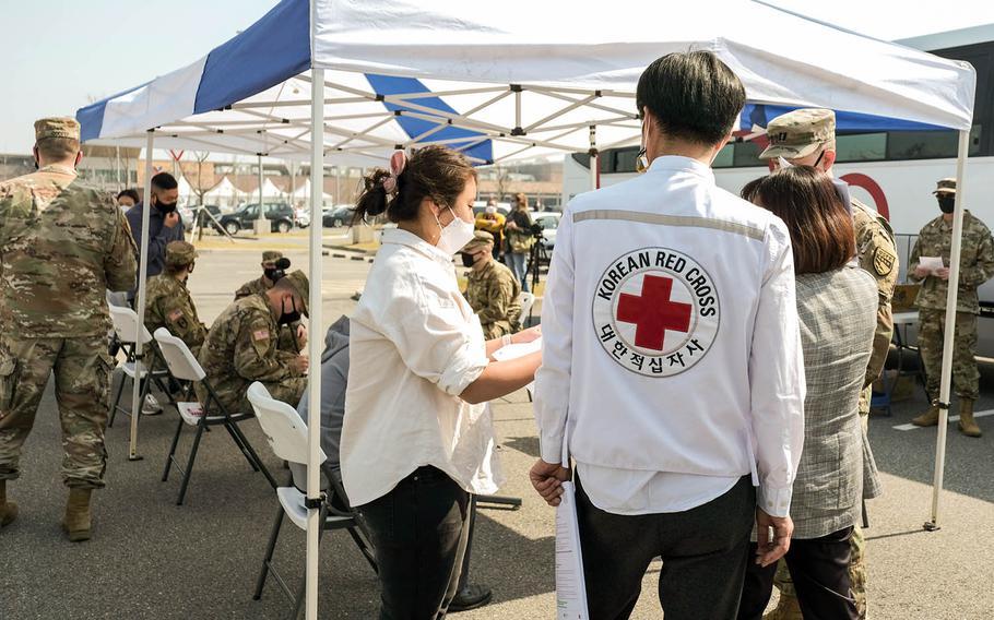 Korean Red Cross representatives prepare for a blood drive at Camp Humphreys, South Korea, Wednesday, April 7, 2021.