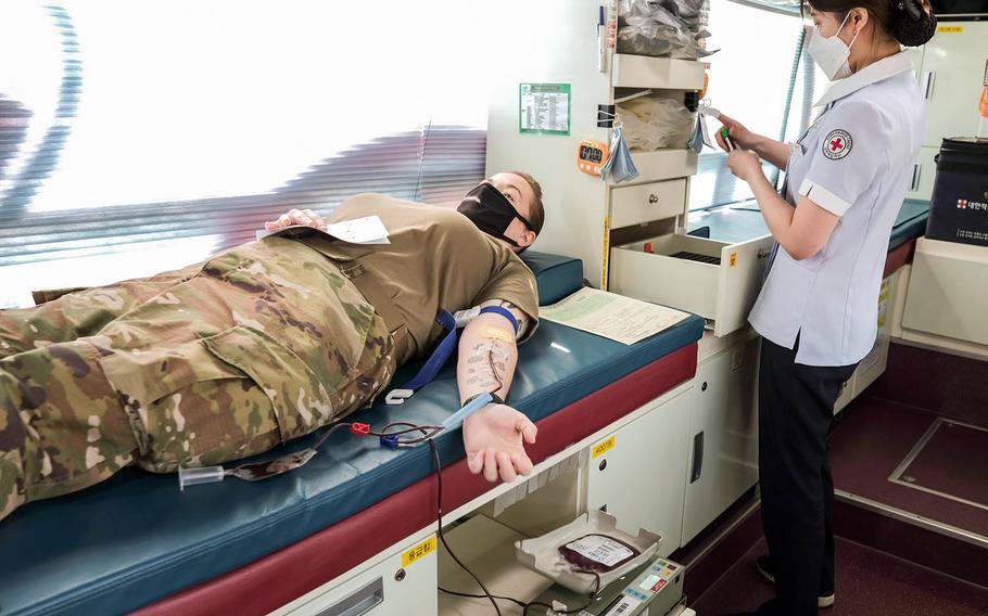 Army Master Sgt. Susan Francis, 36, donates blood to the Korean Red Cross at Camp Humphreys, South Korea, Wednesday, April 7, 2021.
