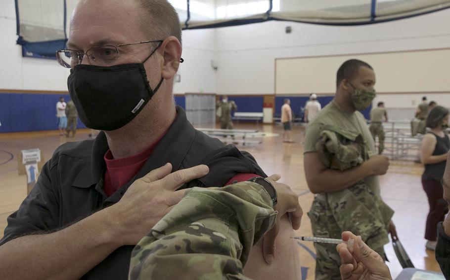 James Watkins, 47, a Boeing employee from Louisiana, receives his second dose of the Moderna coronavirus vaccine at Kadena Air Base, Okinawa, Friday, April 9, 2021.