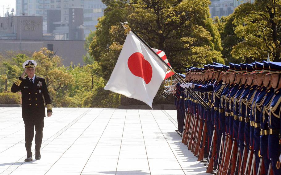 The head of U.S. Indo-Pacific Command, Adm. Philip Davidson, reviews Japanese troops outside the Ministry of Defense in Tokyo, Monday, April 12, 2021.