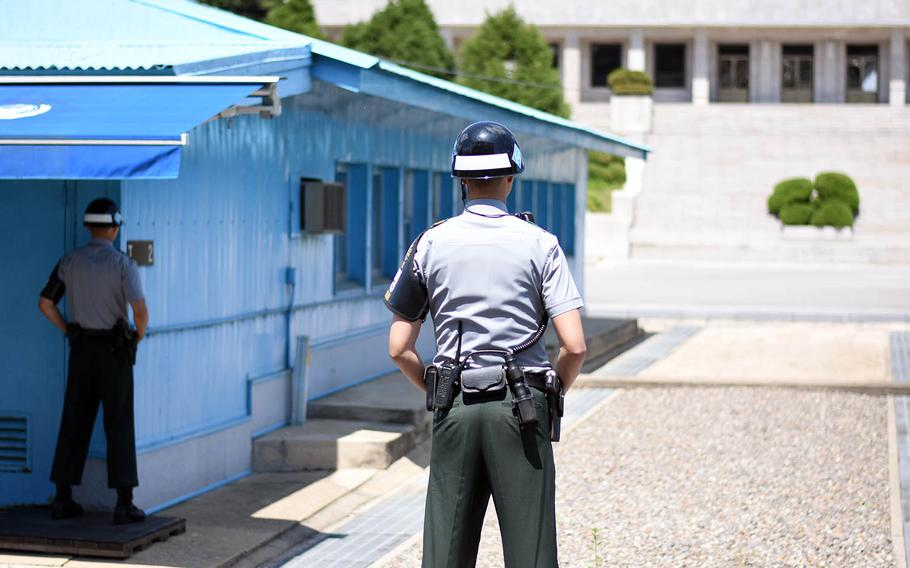 South Korean soldiers stand guard near the border with North Korea inside the Joint Security Area, May 24, 2017.