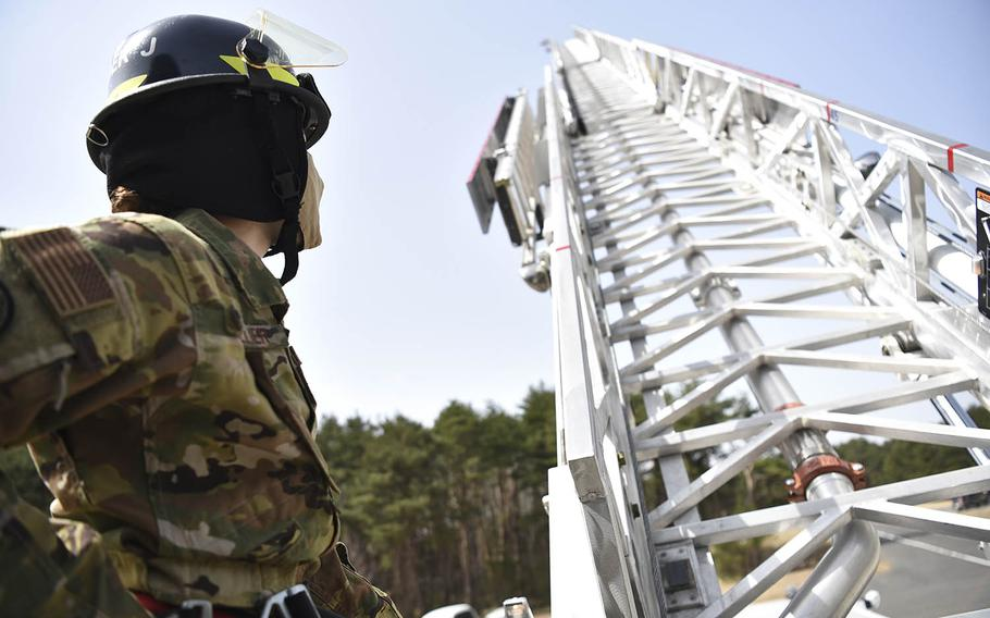 Air Force Staff Sgt. Journey Collier, a 35th Civil Engineer Squadron firefighter, raises a fire truck ladder at Misawa Air Base, Japan, March 31, 2021.
