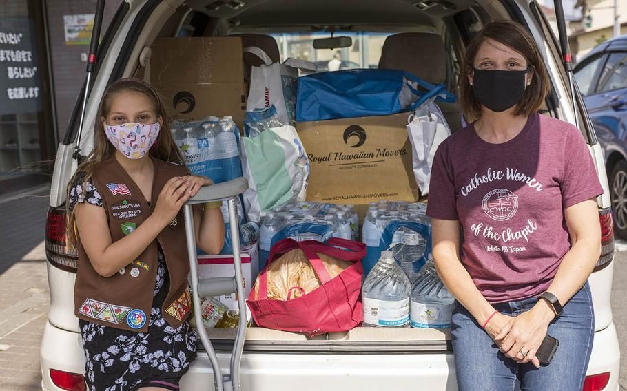This month, Girl Scout Eleanor Pierson, 9, and her mother Danielle collected more than 500 bottles of water and hundreds of nonperishable goods for the homeless near Yokota Air Base in Tokyo, working on crutches after dropping two cans of food and injuring her toe.