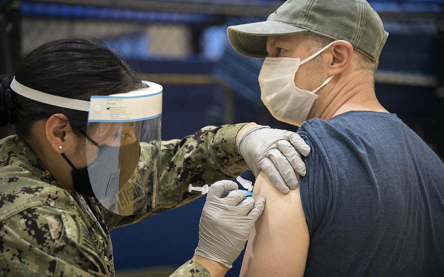 Retired Navy captain Brian Park receives the Moderna COVID-19 vaccine during a shot clinic at Yokosuka Naval Base, Japan, April 21, 2021.