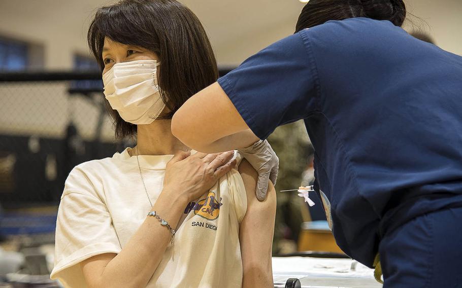 Rikako Park the wife of retired Navy captain Brian Park, receives a dose of the Moderna coronavirus vaccine at Yokosuka Naval Base, Japan, April 21, 2021.