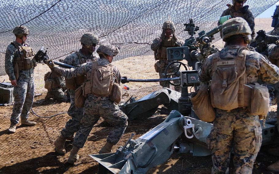 Members of 3rd Battalion, 12th Marine Regiment, 3rd Marine Division prepare to fire an M777 A2 howitzer during artillery relocation training at Camp Fuji, Japan, April 23, 2021.