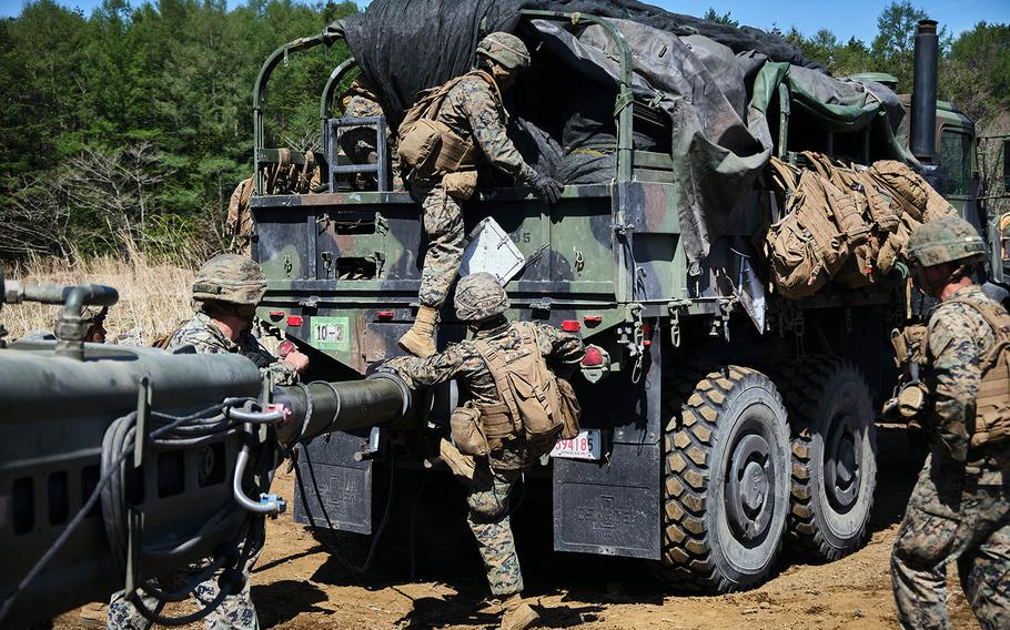 Members of 3rd Battalion, 12th Marine Regiment, 3rd Marine Division take an M777 A2 howitzer to a new firing position, during artillery relocation training at Camp Fuji, Japan, April 23, 2021.