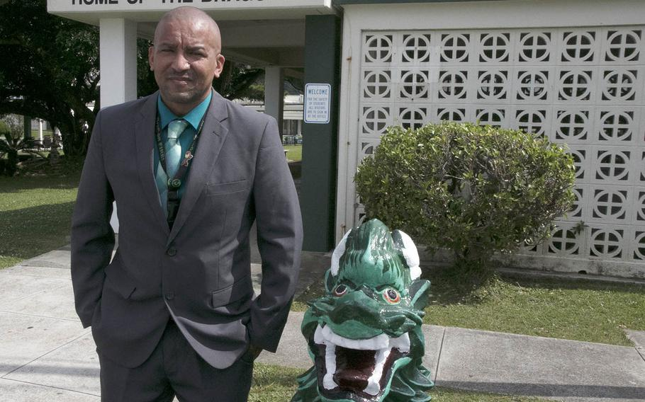 Kubasaki High School principal James Strait poses in front of his school at Camp Foster, Okinawa, Monday, April 26, 2021. Strait has been named Principal of the Year by Department of Defense Education Activity.