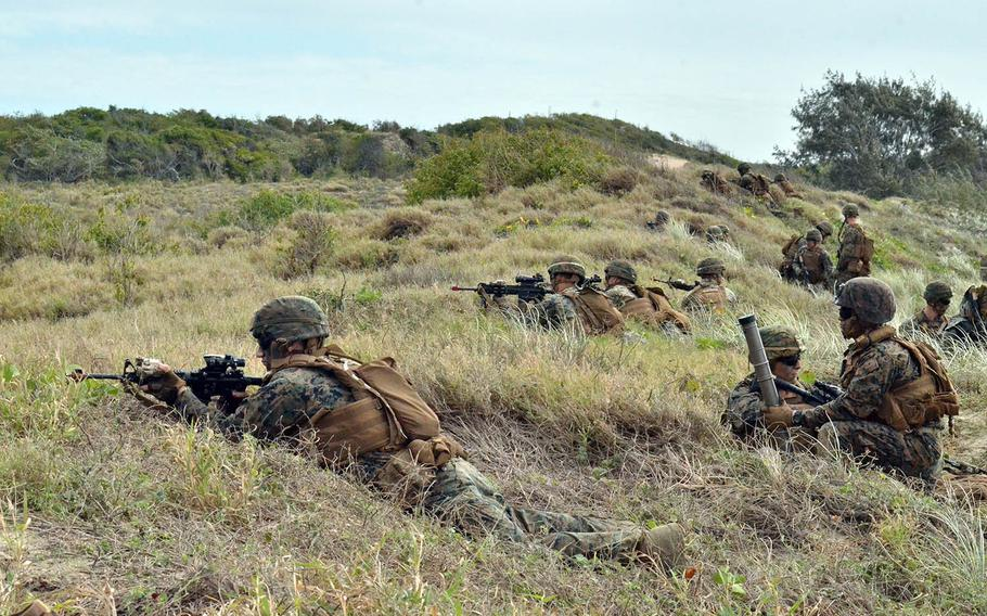 U.S. Marines secure a beach landing zone near Bowen, Australia, during the large-scale Talisman Sabre exercise in July 2019. Australia will invest $582 million to improve bases and training areas in its Northern Territory that are used by a rotational force of U.S. Marines, the country's Defence Department announced Wednesday.