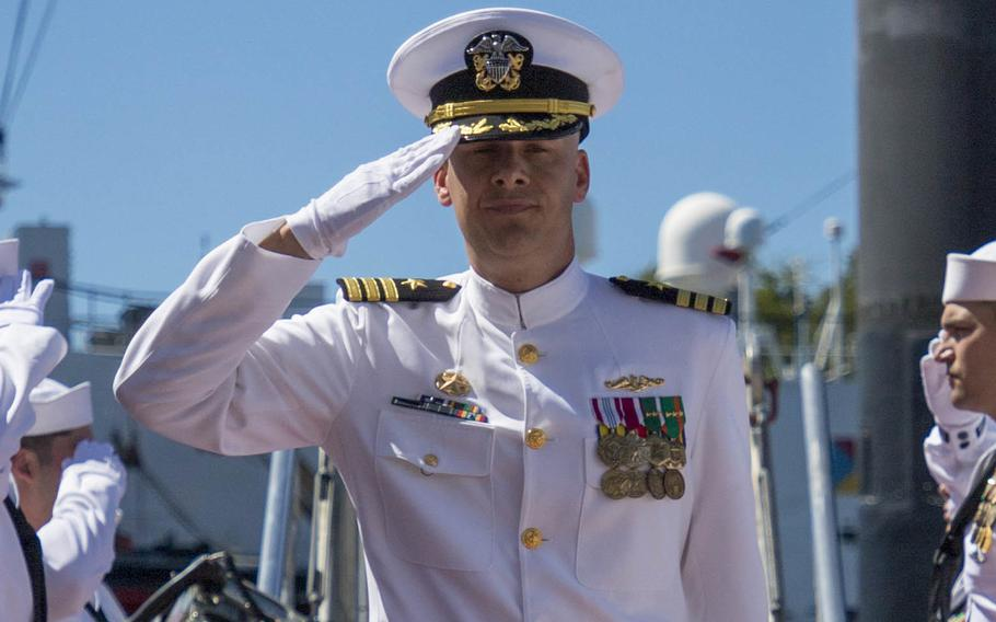 Cmdr. Joseph Lautenslager is piped ashore during the USS Charlotte (SSN 766) change of command ceremony at Joint Base Pearl Harbor-Hickam on March 15, 2019. Lautenslager was relieved of command of the Los Angeles-class fast-attack submarine on Tuesday, April 27, 2021, after a command investigation.